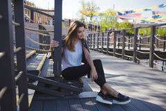 Stylish young woman on summer city walk, sitting on the stairs Royalty Free Stock Photos