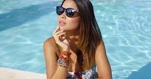 Stylish young woman in sunglasses and bikini stock video footage