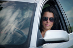 Stylish young woman in sunglasses driving a car stock photos