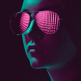 Stylish young woman in sunglasses with pink lens. Headshot of stylish young woman in sunglasses with pink lens Stock Photography