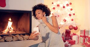 Stylish young woman taking a Christmas selfie Stock Image