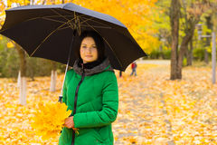Stylish young woman with an umbrella stock photo