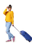 Stylish young woman walking with travel bag Royalty Free Stock Photo