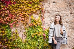 Female model in trendy outfit on the steet wall background stock photos