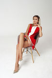 Stylish young woman in white dress and red jacket Royalty Free Stock Image