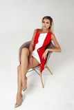 Stylish young woman in white dress and red jacket Stock Images