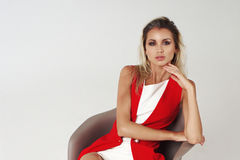 Stylish young woman in white dress and red jacket Stock Photos