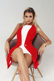 Stylish young woman in white dress and red jacket Royalty Free Stock Images