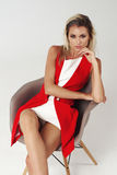 Stylish young woman in white dress and red jacket Royalty Free Stock Photography