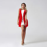 Stylish young woman in white dress and red jacket Royalty Free Stock Photo