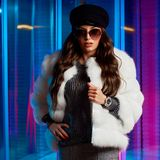 Stylish young woman in white fur coat and round sunglasses stock photography
