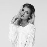 Stylish young woman in white pullover Stock Image
