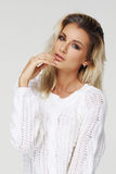 Stylish young woman in white pullover Stock Images