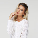 Stylish young woman in white pullover Stock Photos