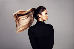 Free Stylish Young Woman With Flying Hair Royalty Free Stock Image - 98075116