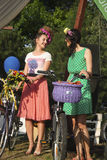 Stylish young women with bikes Stock Photo