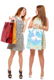 Stylish young women while shopping Royalty Free Stock Photo