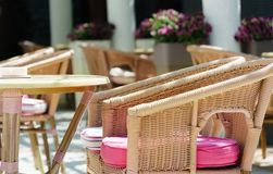 Stylishly decorated table in the restaurant with pink cushions on the chairs against t stock photo