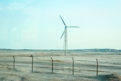 Stylishly practical windmills in the desert background royalty free stock images