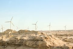 Stylishly practical windmills in the desert background royalty free stock photo