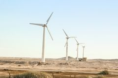 Stylishly practical windmills in the desert background stock photo