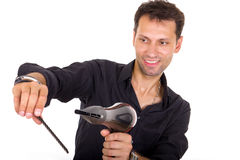 Stylist with blow dryer and comb for hair Stock Photo