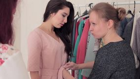 Stylist clothes model in light pink summer dress stock video footage