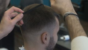 The stylist corrects hair cut at the barber stock footage