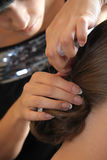 The stylist does a hairdress. Hands of the hairdresser close up Stock Photography