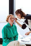 Stylist does a make-up Stock Images