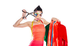 Stylist with face art holds a pair of scissors and dummy. Royalty Free Stock Photo
