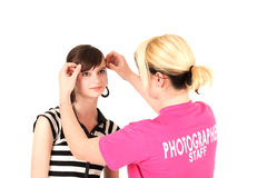 Stylist Fixing Model S Hair Royalty Free Stock Photography