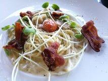 Stylist food, fusion creamy bacon carbonara spaghetti. Closed up stylist food, fusion creamy bacon carbonara spaghetti Stock Images