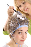 Stylist frosting clients hair Royalty Free Stock Image