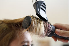 Stylist hairdresser doing haircut Royalty Free Stock Photo