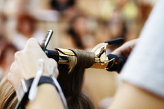 Stylist hairdresser doing haircut Stock Photography