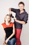 Stylist ironing  woman hair in hairdresser salon Stock Image
