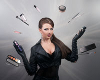 Stylist juggling with brushes and makeup tools Royalty Free Stock Image