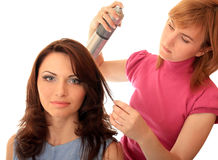 Stylist makes hair. Beautiful girl Stock Photography