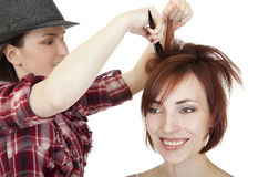 Stylist makes hairstyle. Stock Photos