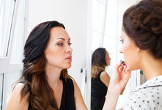 Stylist makes make up for bride on the wedding day Royalty Free Stock Images