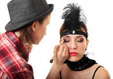 Stylist makes makeup. Royalty Free Stock Images