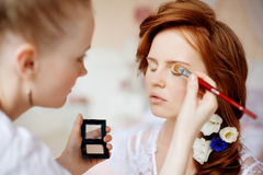Stylist makes makeup bride on the wedding day Stock Photo