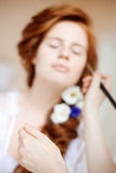 Stylist makes makeup bride before the wedding Stock Image
