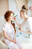 Stylist makes makeup bride before the wedding Stock Photo