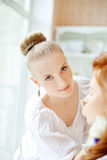 Stylist makes makeup bride before the wedding Stock Images