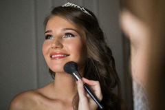Stylist makes makeup bride on the wedding day Stock Photography