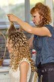 Stylist makes wedding hairstyle Stock Image