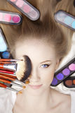Stylist makeup artist with brushes and cosmetics