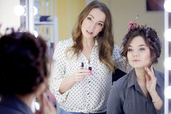 Stylist Makeup Artist Doing Makeup And Hair In A Beauty Salon. Professional Make-up Royalty Free Stock Image